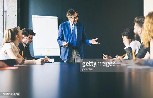 Senior businessmen giving a presentation