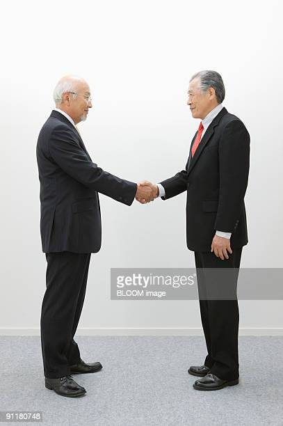 Senior businessmen shaking hands