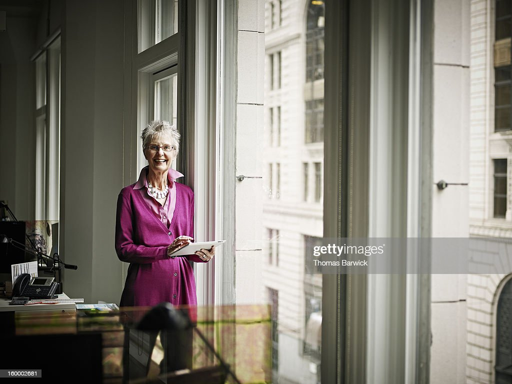 Senior businesswoman holding digital tablet : Stock Photo