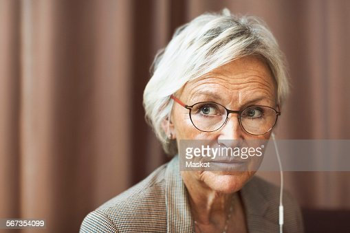senior businesswoman looking away in office photo getty images. Black Bedroom Furniture Sets. Home Design Ideas