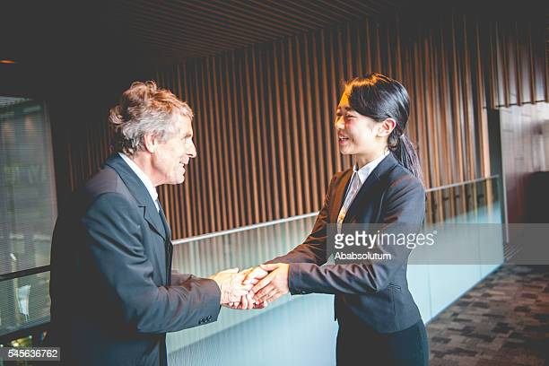 Senior Caucasian Businessman and Japanese Entrepreneur Shaking Hands, Kyoto, Japan