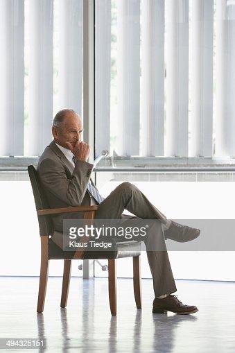 Senior Caucasian businessman sitting in chair