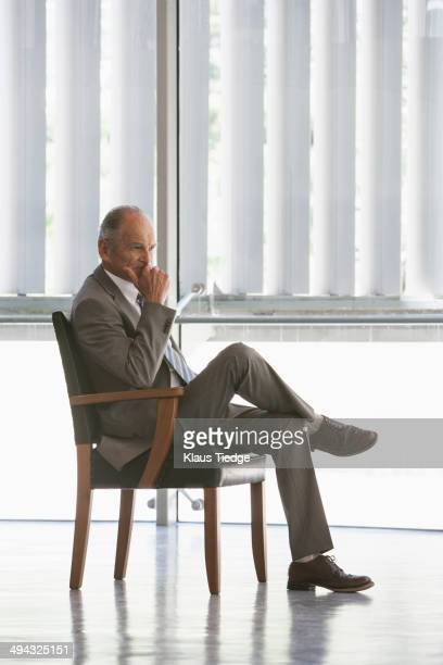 Senior Caucasian businessman sitting in chair