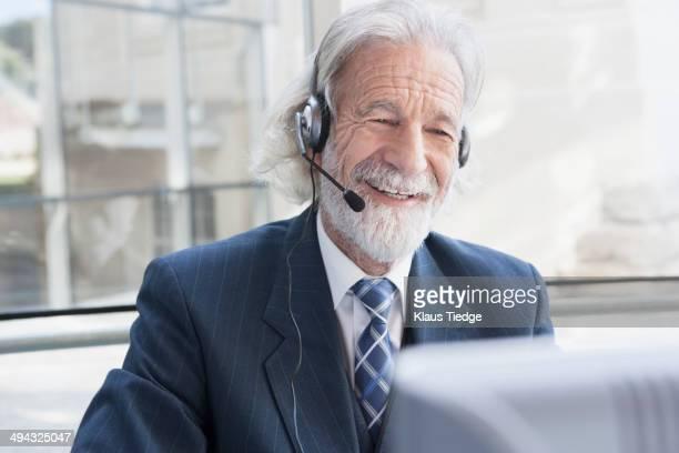 Senior Caucasian businessman talking on headset