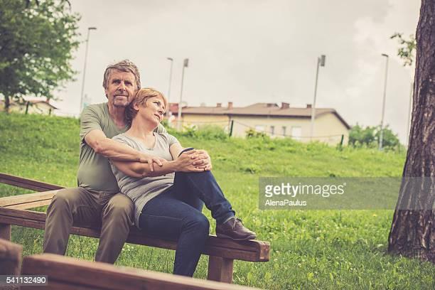 Senior caucasian couple hugging outdoors