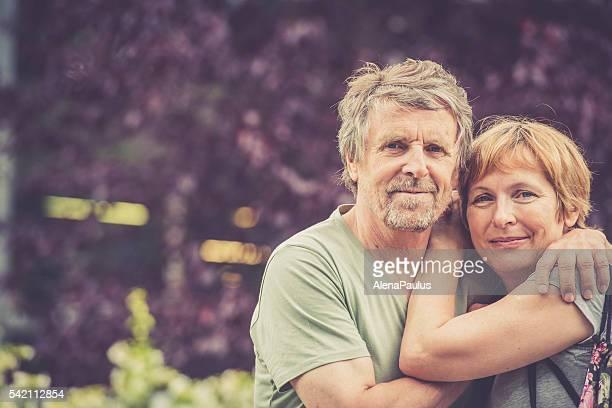 Senior caucasian couple in love - hugging outdoors