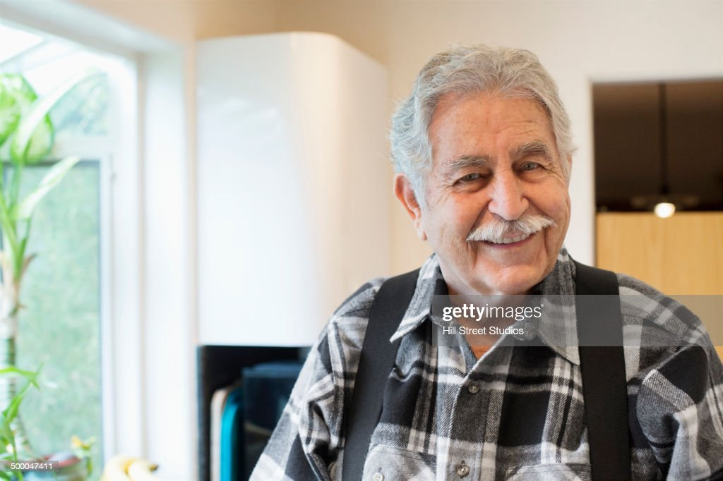 Senior Caucasian man smiling in kitchen