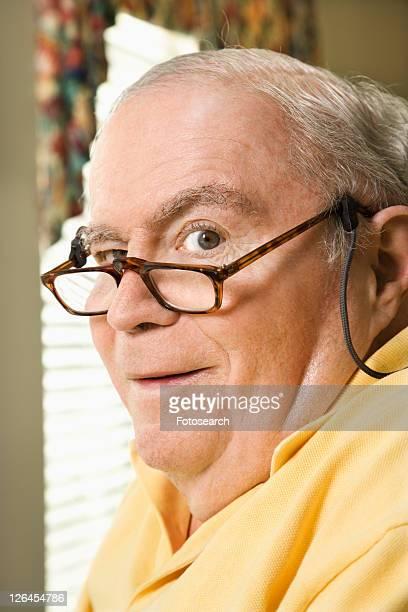 Senior Caucasian man with bifocals.