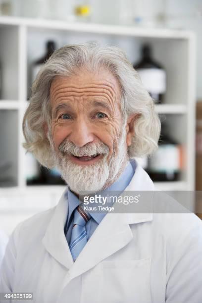 Senior Caucasian scientist smiling in lab