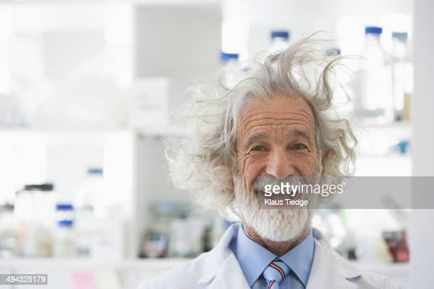 Senior Caucasian scientist with unruly hair in lab
