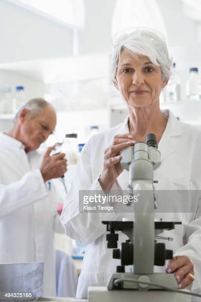 Senior Caucasian scientists working in lab