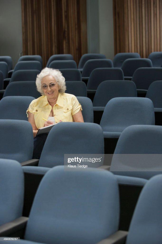 Senior Caucasian student sitting in classroom