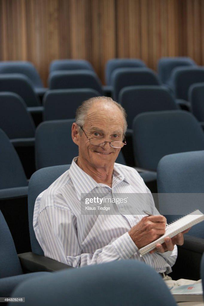 Senior Caucasian student working in classroom