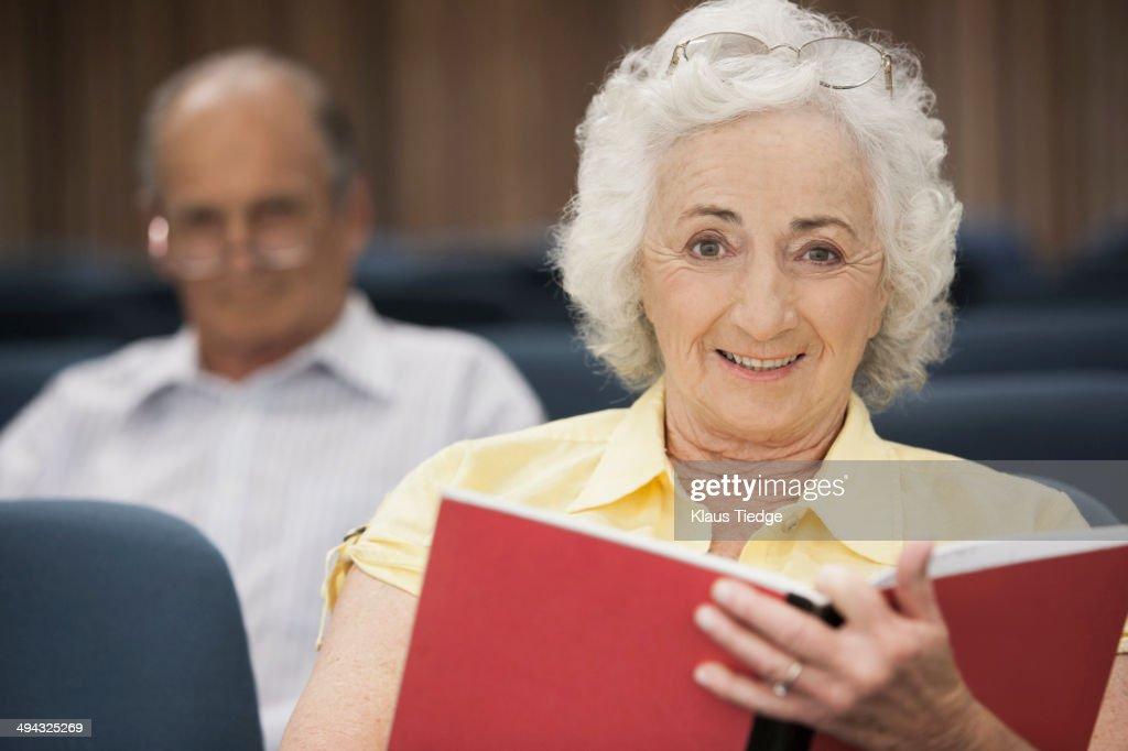 Senior Caucasian students sitting in classroom