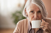 Senior Caucasian woman drinking cup of tea