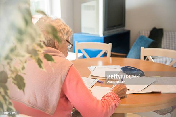 Senior Caucasian Woman Studying at Home, Brac, Croatia