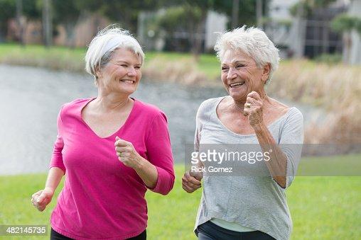 Senior Caucasian women jogging in park