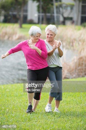 Senior Caucasian women playing in park