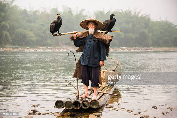 Senior Chinese Fisherman Returns Home with Cormorants Li River China