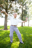 Senior Chinese man doing tai chi outdoors