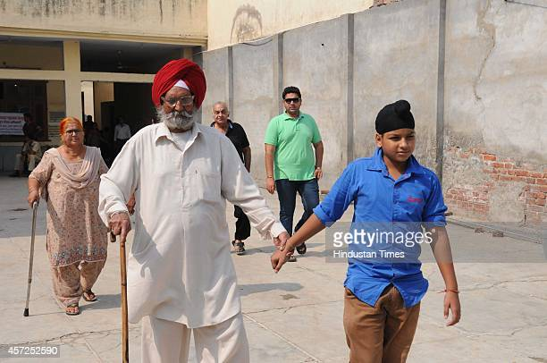 A senior citizen coming out from polling booth after casting his Vote on October 15 2014 in Ambala India Polls in Haryana are going well with voter...