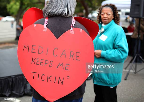 A senior citizen holds a sign during a rally to protect federal health programs at the 8th Annual Healthy Living Festival on July 15 2011 in Oakland...