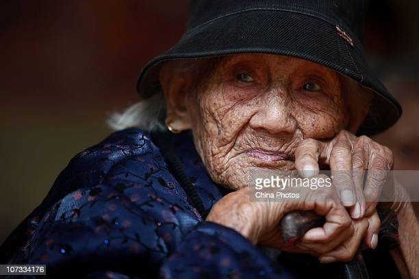 Senior citizen Liu Yuhua 104yearold rests at the Huangzhu Village of Jinjiang Township on December 4 2010 in Chengmai County of Hainan Province China...