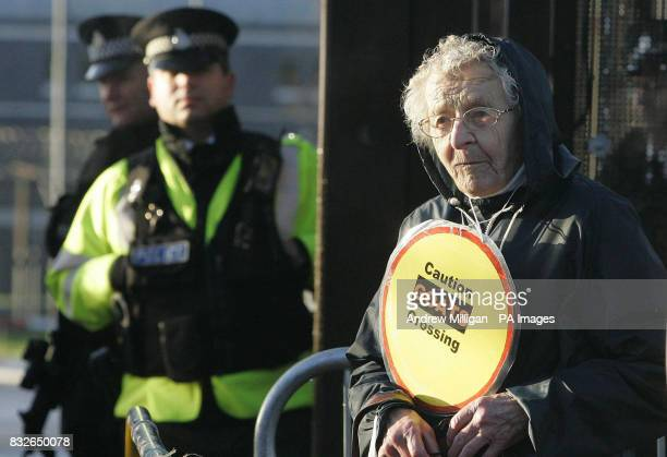 A senior citizen protests outside Faslane on the River Clyde Scotland the Trident nuclear submarine base