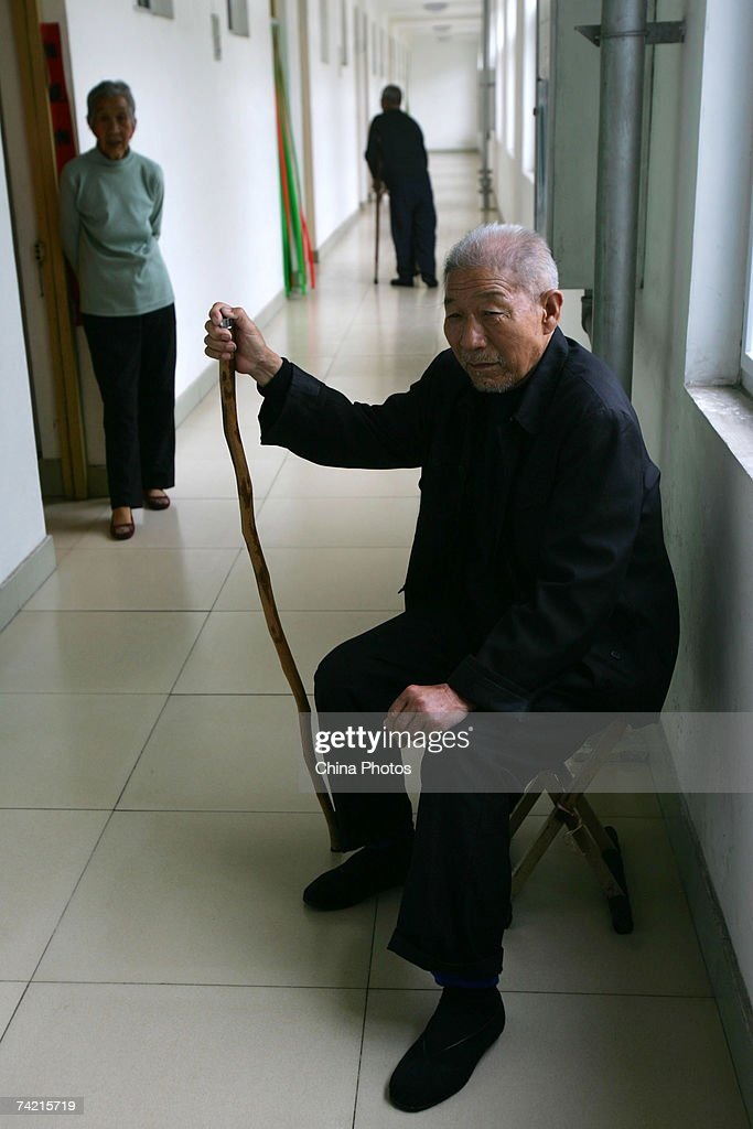 A senior citizen rests at the corridor of a care center on May 22, 2007 in Zibo of Shandong Province, China. According to state media, China is moving towards an older society. China currently has about 140 million elderly citizens, and the figure will keep growing at an annual rate of 3.2 percent in the next 50 years.