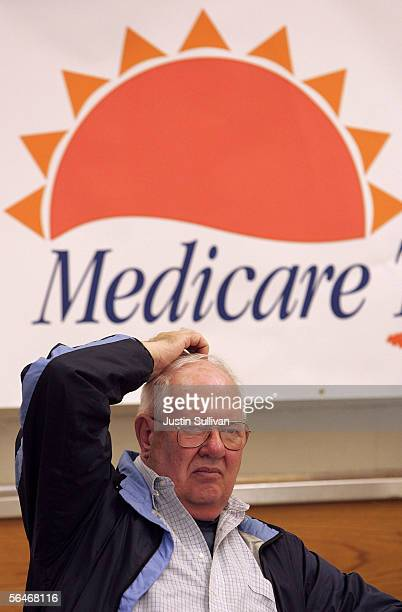 A senior citizen scratches his head as he lisens to a seminar on how to sign up for the new Medicare drug prescription program during a Medicare...