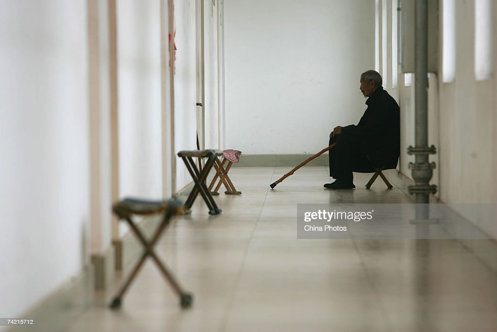 A senior citizen sits at the corridor of a care center on May 22, 2007 in Zibo of Shandong Province, China. According to state media, China is moving towards an older society. China currently has about 140 million elderly citizens, and the figure will keep growing at an annual rate of 3.2 percent in the next 50 years.