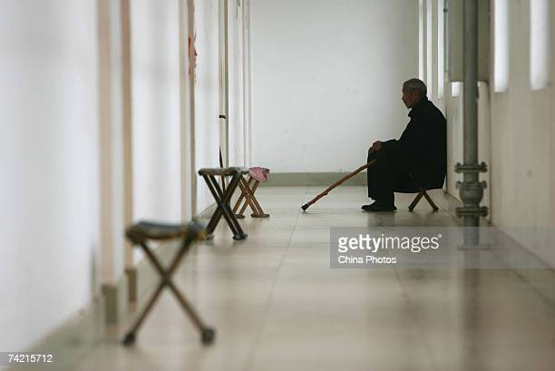 A senior citizen sits at the corridor of a care center on May 22 2007 in Zibo of Shandong Province China According to state media China is moving...