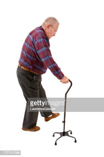 Senior citizen using a quad cane