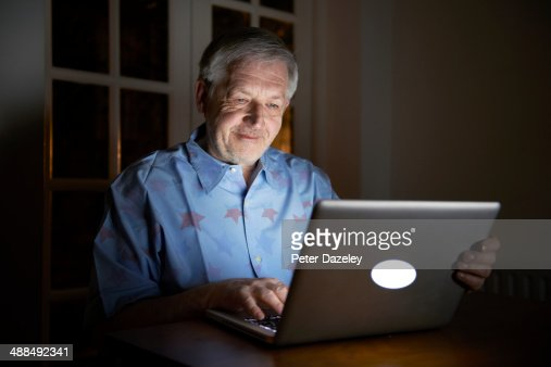 Senior Citizen Working Late Stock Photo Getty Images