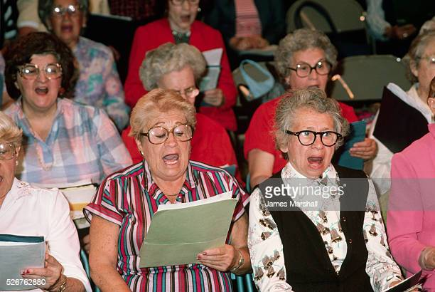 Senior citizens sing in an intergenerational chorus at a Jewish Community Center