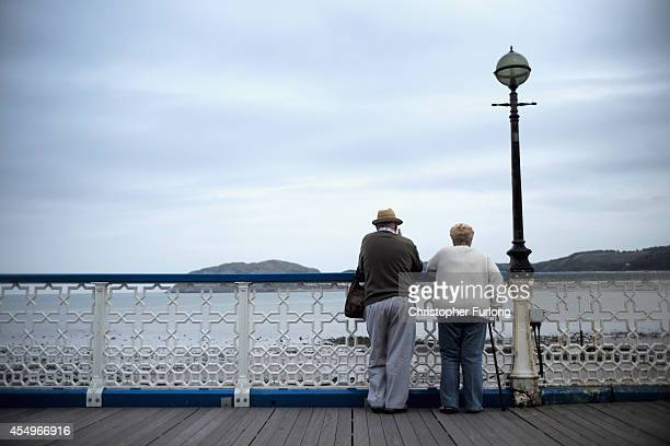 Senior citizens walk along Llandudno Pier on September 8 2014 in Llandudno Wales Britain is facing multiple problems stemming from an increase in the...