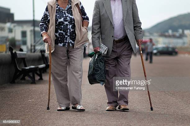 Senior citizens walk along Llandudno Promenade on September 8 2014 in Llandudno Wales Britain is facing multiple problems stemming from an increase...