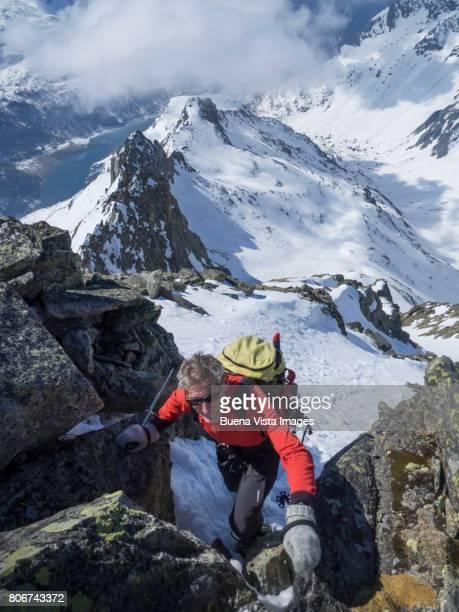 Senior climber on a mountain
