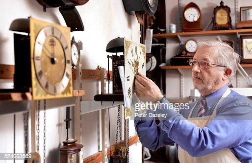 Senior clock repairer in workshop