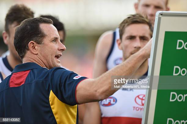 Senior coach Don Pyke of the Crows speaks to his players during the round nine AFL match between the Gold Coast Suns and the Adelaide Crows at...