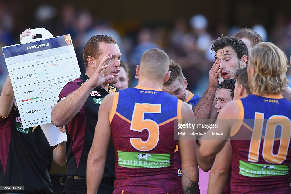 Senior coach, <a gi-track='captionPersonalityLinkClicked' href=/galleries/search?phrase=Justin+Leppitsch&family=editorial&specificpeople=214621 ng-click='$event.stopPropagation()'>Justin Leppitsch</a> of the Lions speaks to his players during the round 10 AFL match between the Brisbane Lions and the Hawthorn Hawks at The Gabba on May 28, 2016 in Brisbane, Australia.