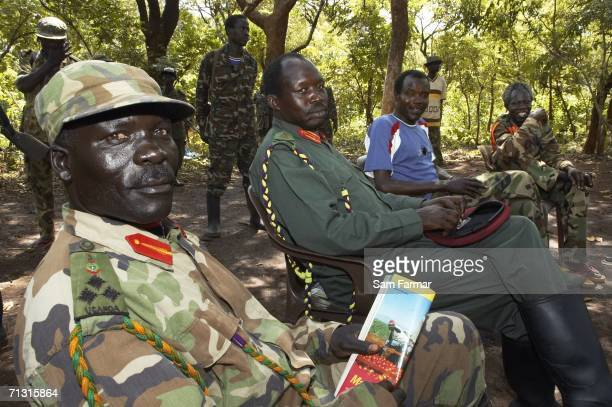Senior commanders of the Ugandan rebel group the Lord's Resistance Army Abudema Okot Odiambo Joseph Kony and Vincent Otti pose for the camera during...