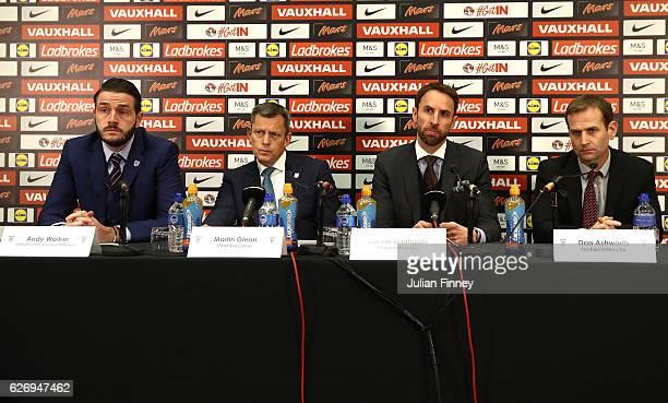 Senior Communications Manager Andy Walker FA Chief Executive Martin Glenn and FA Technical Director Dan Ashworth look on as Gareth Southgate speaks...