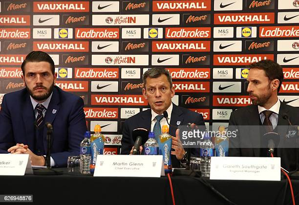 FA Senior Communications Manager Andy Walker FA Chief Executive Martin Glenn and Gareth Southgate attend at a press conference as he is unveiled as...