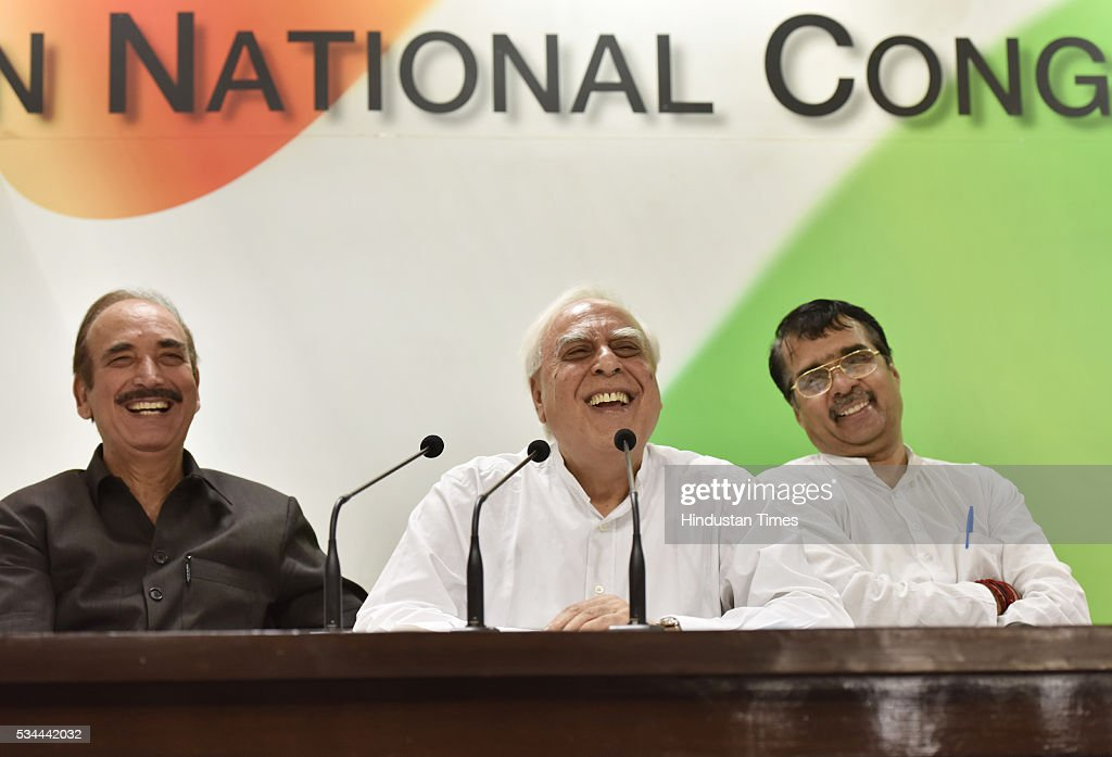 Senior Congress leaders Kapil Sibal and Ghulam Nabi Azad during the press conference on completion of two years of BJP-led government at AICC HQ on May 26, 2016 in New Delhi, India. Main opposition party questioned the hype and elaborate celebrations of the Modi government alleging that its achievements were nothing but empty talk and hollow promises.