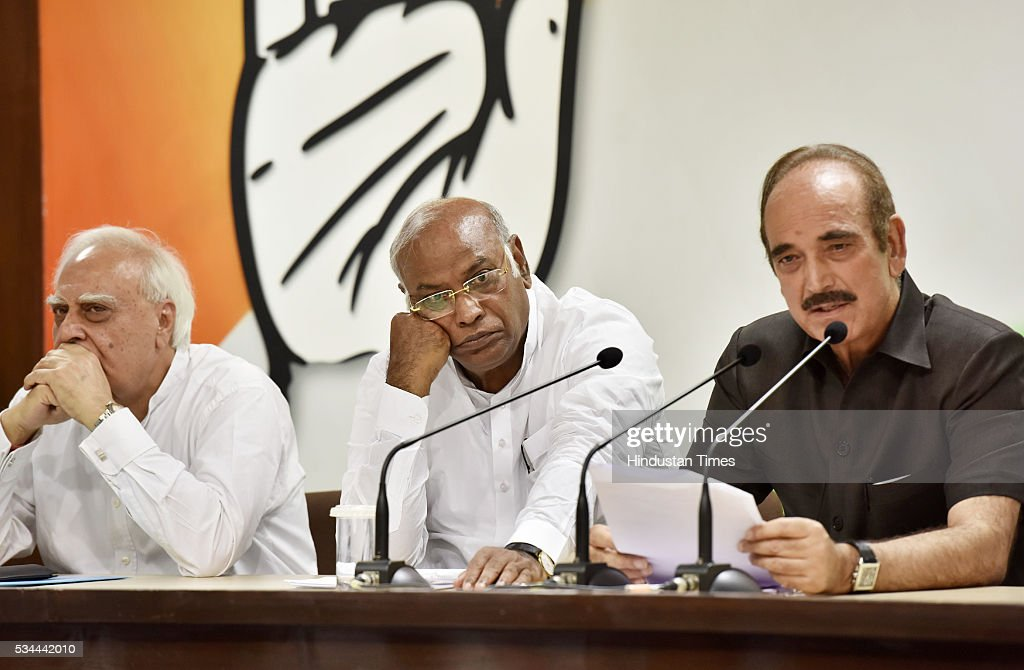 Senior Congress leaders Kapil Sibal, Mallikarjun Kharge and Ghulam Nabi Azad during the press conference on completion of two years of BJP-led government at AICC HQ on May 26, 2016 in New Delhi, India. Main opposition party questioned the hype and elaborate celebrations of the Modi government alleging that its achievements were nothing but empty talk and hollow promises.
