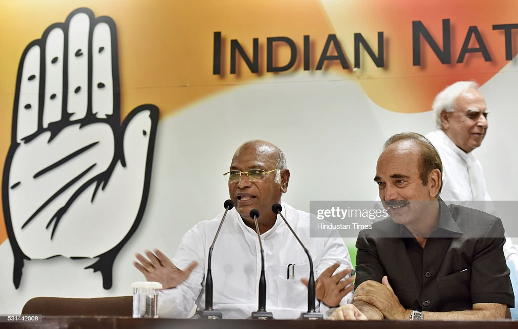 Senior Congress leaders Mallikarjun Kharge and Ghulam Nabi Azad during the press conference on completion of two years of BJP-led government at AICC HQ on May 26, 2016 in New Delhi, India. Main opposition party questioned the hype and elaborate celebrations of the Modi government alleging that its achievements were nothing but empty talk and hollow promises.