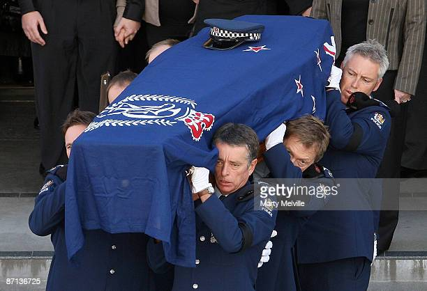 Senior Constable Len Snee's casket is carried from the Theatre by Police officers after his funeral at the Municipal Theatre on May 13 2009 in Napier...