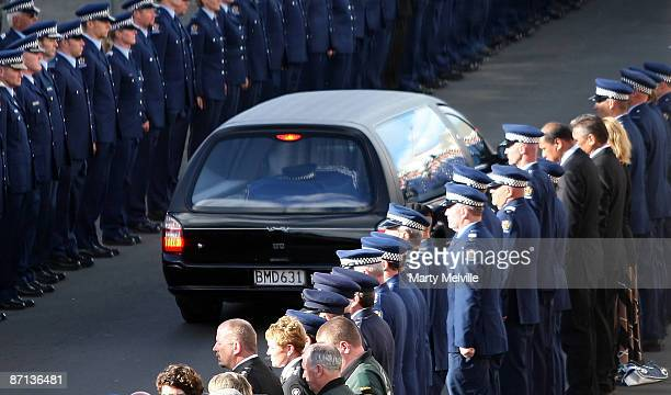 Senior Constable Len Snee's casket is driven through the police guard of honour after his funeral at the Municipal Theatre on May 13 2009 in Napier...