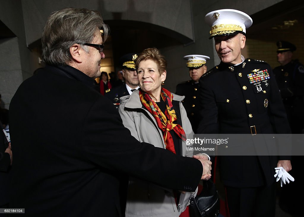 Senior Counselor Steve Bannon (L) and Chairman of the Joint Chiefs of Staff Gen. Joseph F. Dunford greet each other before the presidential inauguration on the West Front of the U.S. Capitol on January 20, 2017 in Washington, DC. In today's inauguration ceremony Donald J. Trump becomes the 45th president of the United States.